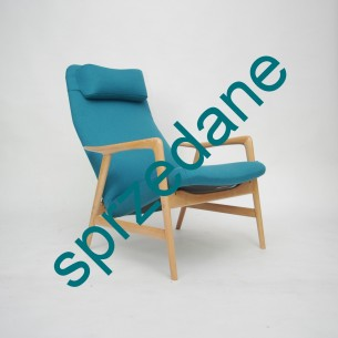 Projekt ALFa SVENSSONa dla firmy STUDIO (projekt realizowany również przez Fritz Hansena oraz Dux). Modernistyczna, ergonomiczna forma lat 60-tych. Siedzisko i plecy na sprężynach. Regulacja przechyłu, dwie pozycje. Drewno bukowe. Kolor tapicerki turkusowy, zgodny z oryginałem. Projekt 1957 roku