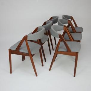 Set krzeseł  #31 autorstwa KAI KRISTIANSENa; manufaktura SCHOU ANDERSEN. Lata 60-te. Piękna, ergonomiczna forma. Konstrukcja z olejowanego masywu tekowego. Siedziska na pasach. Tapicerka wełniana w szarym kolorze. Oryginalny produkt duński.