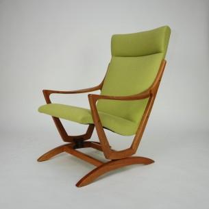 Dębowy fotel na biegunach. Piękna organiczna forma lat 60-tych. Poszycie bawełniane.