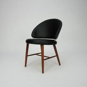 Wyrafinowane krzesło z masywu palisandru.  Piękna modernistyczna forma. Skóra naturalna (wysokogatunkowa, półanilinowa). Drewno olejowane.