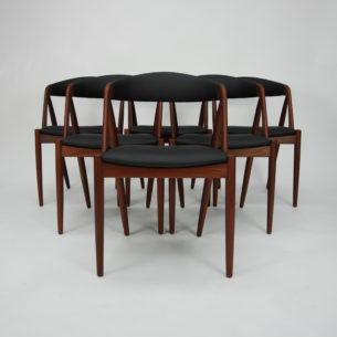 Krzesło tekowe, model #31 autorstwa KAI KRISTIANSENa; manufaktura SCHOU ANDERSEN. Lata 60-te. Piękna, ergonomiczna forma. Konstrukcja z olejowanego masywu tekowego. Siedziska na pasach. Tapicerka wełniana w szarym kolorze. Oryginalny produkt duński.